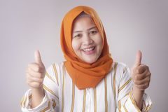 Muslim Lady Shows Thumbs Up Gesture stock photo
