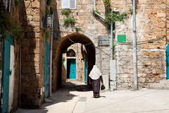 Muslim lady walking in a street of Akko Royalty Free Stock Photos