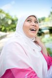 Muslim Malay woman smiling in an outdoor park Stock Photo