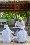 Muslim maldivian senior dhivehi orthography teacher giving lesson to his students stock photos