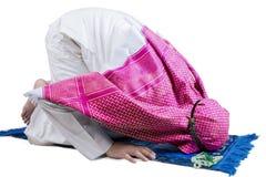 Muslim male posing prostration on studio Stock Photo