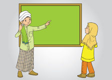 Muslim male teacher and female student Stock Photography
