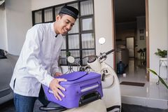 Muslim male travelling for eid mubarak lebaran by motorcyle. Asian muslim male travelling for eid mubarak lebaran by motorcyle. mudik balik kampung concept by royalty free stock photography