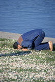 Muslim man. Praying outside on the ground. Blur Royalty Free Stock Photography