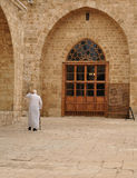 Muslim man. Old muslim men walking inside a mosque stock images