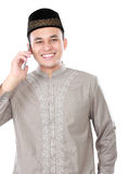 Muslim man calling by mobile phone Royalty Free Stock Photography