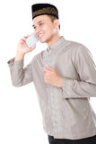 Muslim man calling by mobile phone Royalty Free Stock Photo
