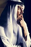 Muslim man in a deep thought. And looking outdoors through a window Royalty Free Stock Photos