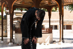 Muslim Man In Dishdasha Praying At Mosque Royalty Free Stock Photos