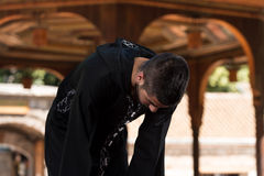 Muslim Man In Dishdasha Is Praying In The Mosque Royalty Free Stock Photo