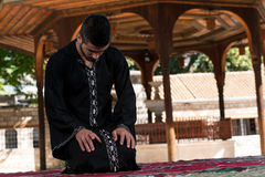 Muslim Man In Dishdasha Is Praying In The Mosque Royalty Free Stock Image