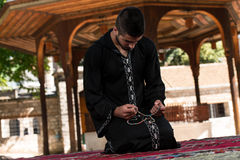 Muslim Man In Dishdasha Is Praying In The Mosque Stock Images