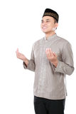 Muslim man doing prayer Stock Photos