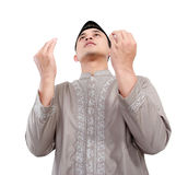 Muslim man doing prayer. Isolated over white background stock images