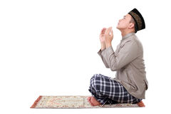 Muslim man doing prayer. Isolated over white background royalty free stock photos