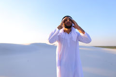 Muslim man feels headache and general malaise, suffers from stan Stock Photos