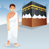Muslim Man in Front of Kaaba. A vector illustration of Muslim Man in Front of Kaaba Royalty Free Stock Images