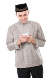 Muslim man holding mobile phone Stock Photo