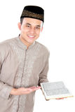 Muslim man holding quran Stock Photos