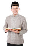 Muslim man holding quran Stock Image
