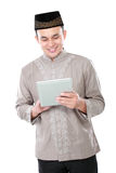 Muslim man holding tablet pc Stock Photo