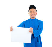 Muslim man. Holding a white board Royalty Free Stock Photography