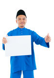 Muslim man. Holding a white board and raised his thumb up Stock Photos