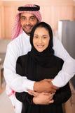 Muslim man hugging wife stock images