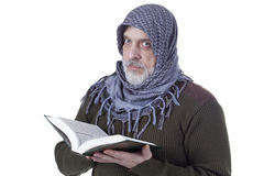 Muslim man with the Koran in their hands Stock Photos