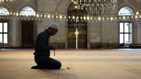 Muslim man at the mosque, worship with prayer beads or rosary. Young adult caucasian muslim man at the mosque, worship with prayer beads or rosary stock video