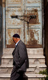 Muslim man passing Istanbul doorway. ISTANBUL, TURKEY – APRIL 28: Muslim man passing by doorway prior to ANZAC day on April 28, 2012 in Ankara, Turkey.  Each Stock Photo