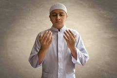 Muslim man praying. For hope Royalty Free Stock Image