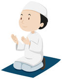 Muslim man praying on the mat Royalty Free Stock Photo