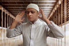 Muslim man praying. In mosque Stock Photos