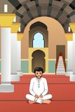 Muslim Man Praying in a Mosque stock photo