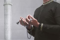 Muslim man praying with prayer beads. Inside the mosque Stock Photography