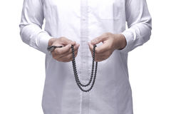 Muslim man praying with prayer beads Royalty Free Stock Photos