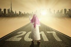 Muslim man praying on road with 2017 Stock Image