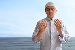 Muslim man praying. With sea background Royalty Free Stock Photography