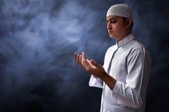 Muslim man praying. With smoke background Royalty Free Stock Image