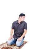 Muslim man is praying on traditional way. In Ramadan Royalty Free Stock Photo