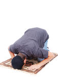 Muslim man is praying on traditional way. Isolated in white Royalty Free Stock Photo