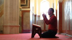 Muslim man praying and worship at mosque stock footage