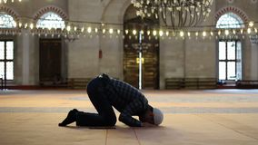 Muslim man praying and worship at mosque. N stock video footage