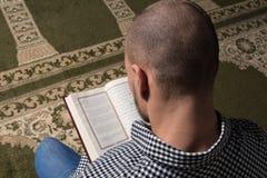 Muslim Man Reading Holy Islamic Book Koran Stock Photos