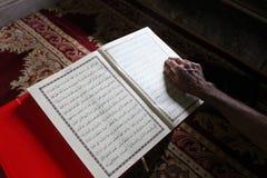 Muslim man reading the Koran Royalty Free Stock Photo