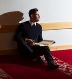 Muslim man reading Koran in mosque Royalty Free Stock Photo