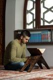 Muslim Man Is Reading The Koran Royalty Free Stock Photos