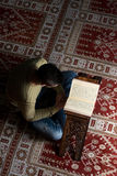 Muslim Man Is Reading The Koran Royalty Free Stock Photography