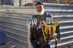 Muslim man sell rosaries. ISTANBUL TURKEY OCTOBER 08: Muslim man sell rosaries in the heart of downtown Istanbul on october 08 2013. In Turkey according Royalty Free Stock Photos